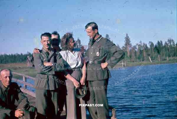 134th Gebirgsjaeger Division soldiers with a local woman in Finland 1944