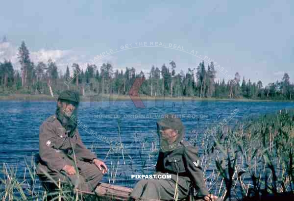 134th Gebirgsjaeger, Finland 1944, german soldier in boat on river, mosquito mask