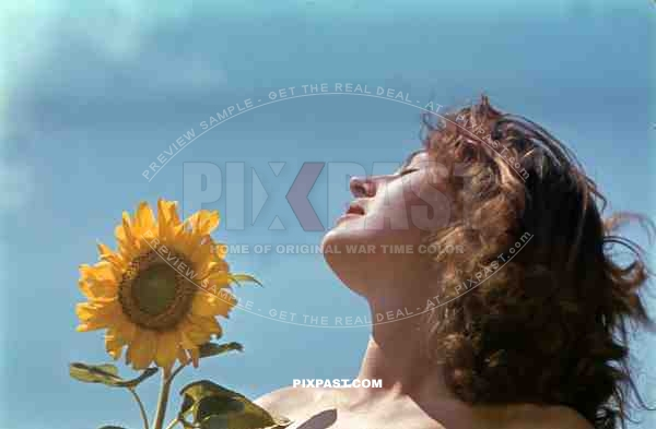 beautiful hungarian woman naked in flower field, Hungary 1942