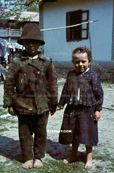 farm children stand to attention for german soldier, Yugoslavia, 1941