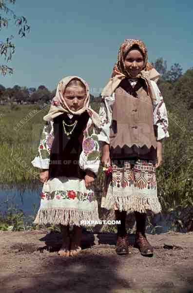 http://www.pixpast.com/static2/preview2/stock-photo-farming-children-in-poltava-ukraine-1941-wearing-traditional-local-costume-12671.jpg