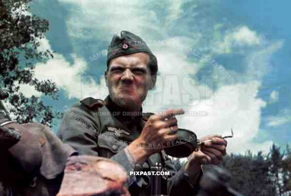 German artillery soldier near French coast France 1940 not enjoying his food rations.