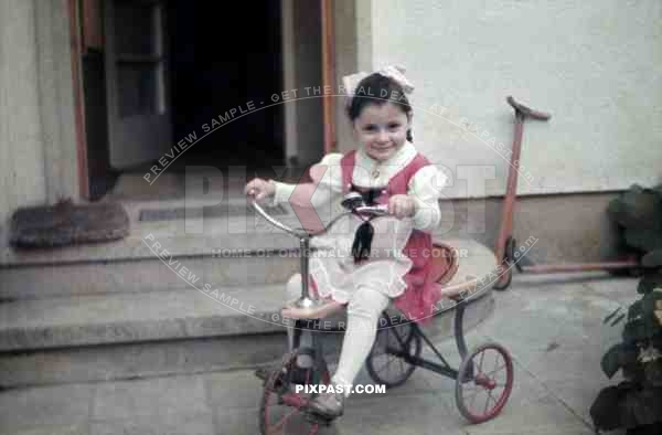 little girl on tricycle, Germany 1938