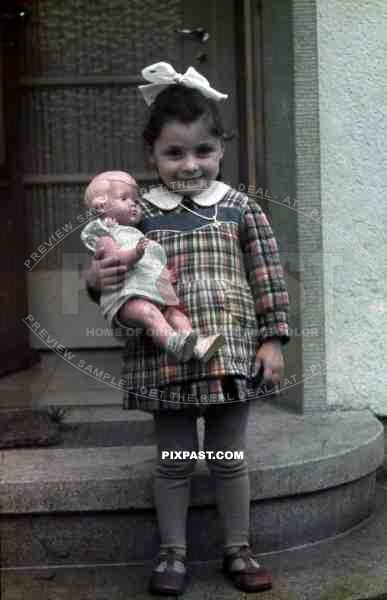 little girl with her doll, Germany 1938