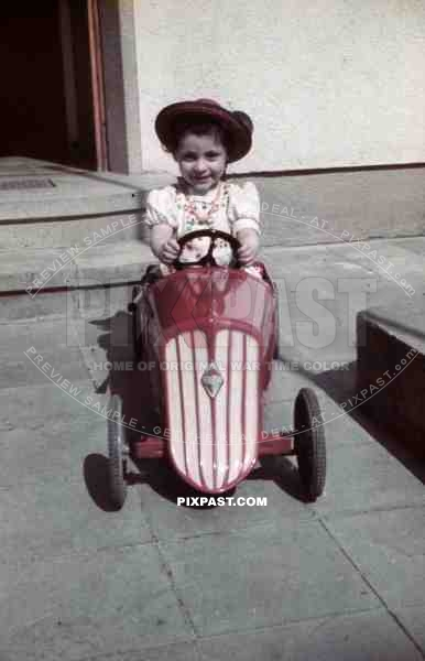 little girl with pedal car, Germany 1939