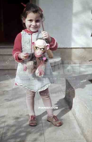 little girl with toy monkey, Germany 1938