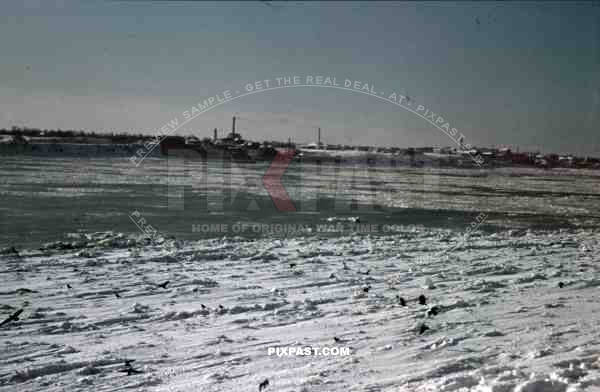 Minsk, Russia, 1942, snow, winter, Village and factory in front of frozen river.