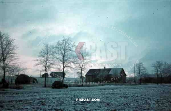 Russia Minsk, 1942, winter, snow Luftwaffe ground crew staff car beside Russian village,