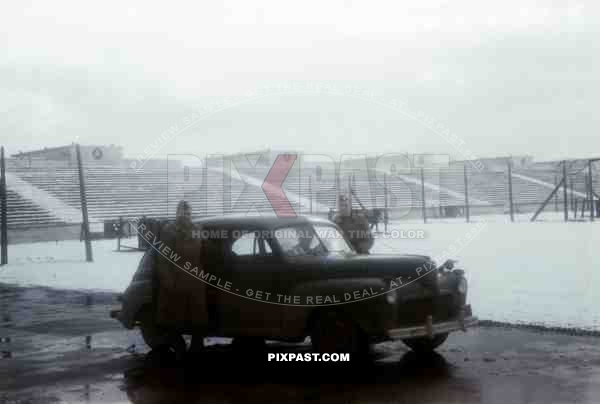 US officers with Sedan Ford Light 1941 Model Staff Car, Soldiers Field, US Army captured Nuremberg Rally field 1945.