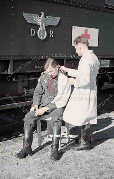 Wehrmacht soldier getting haircut near the Leipzig main ...